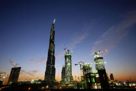 ongoing: Ongoing construction on the tallest building in the world. A whole town is being created around this new icon. Stock Photo