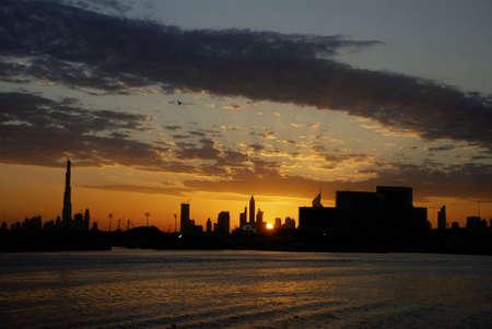 burg: A beautiful cloudy sunset over Dubai with the Burg Dubai on the left. Stock Photo