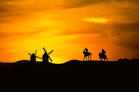 don quijote: Don Quijote y Sancho Panza se van hacia los molinos de viento