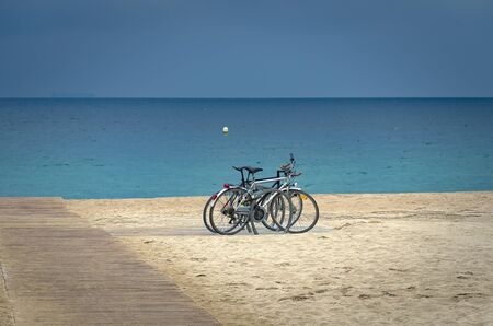 Bicycles on Barcelona beach Imagens