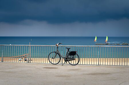 Bicycle on Barcelona beach in summer