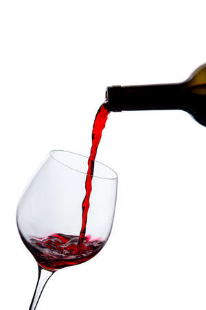 quencher: wine is poured into a glass on a white background