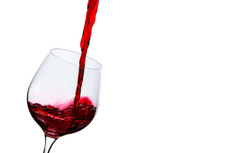 poured: wine is poured into a glass on a white background