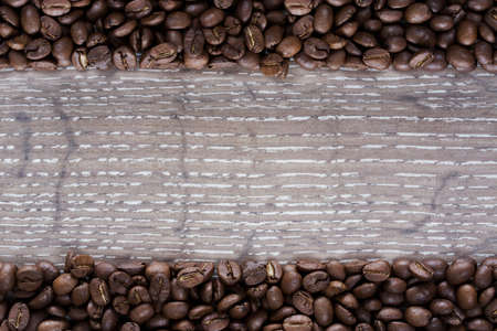 cofe: two rows of coffee beans on a wooden background