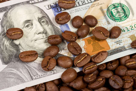 one hundred dollar bill: coffee beans and one hundred dollar bill Stock Photo