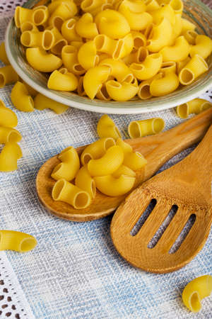 handful: a handful of pasta in the dish Stock Photo