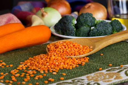 handful: handful of red lentils on a table Stock Photo