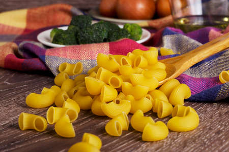 handful: a handful of pasta on the table
