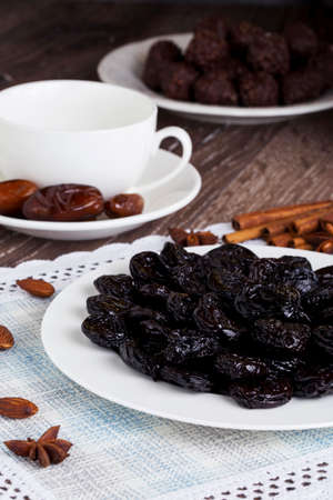 prunes: handful of prunes on a white plate