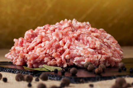 mincing: minced meat on a black cutting board Stock Photo