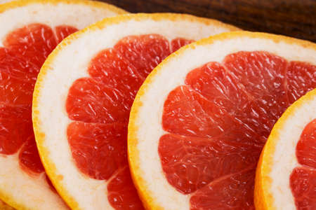 identical: a juicy grapefruit cut by identical rings Stock Photo