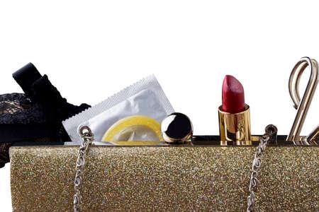 coitus: condom and lipstick in a female handbag Stock Photo
