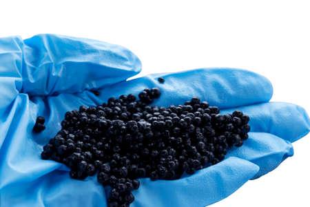 handful: a handful of black caviar in hand Stock Photo