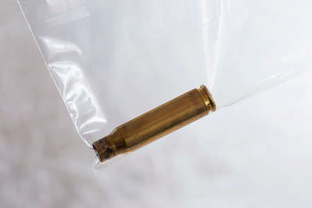 casings: shell casings is in the package for evidence Stock Photo