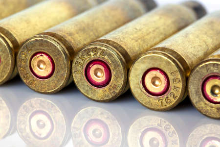 casings: the cartridge cases on a white background Stock Photo
