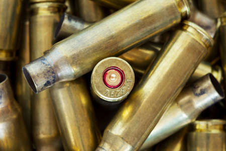 criminology: a handful of the used shell casings