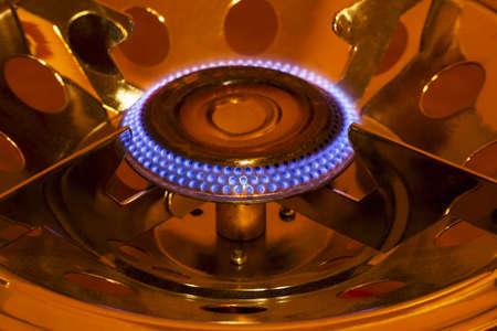 gas burner is lit in the dark
