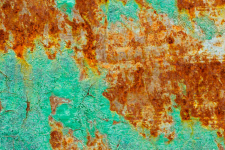rusting: the old paint and a rusting metal