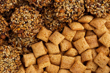 handful: a handful of dry cereal in the shape of squares Stock Photo