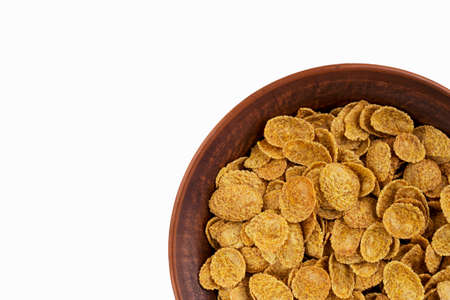 handful: a handful of dry cereal in a bowl