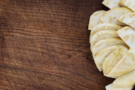 celery root: chopped celery root on a wooden background Stock Photo