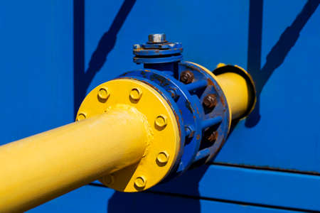 methane: the gas valve on a yellow pipe