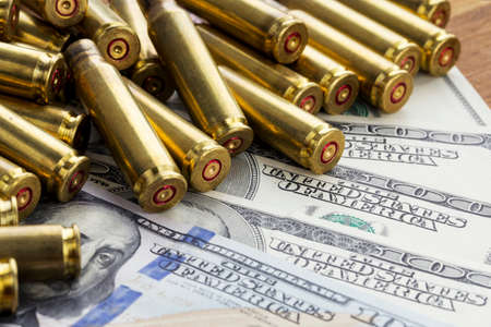 casings: the used shell casings is on a money