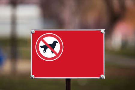 the sign prohibiting walking dogs in a park Stock Photo