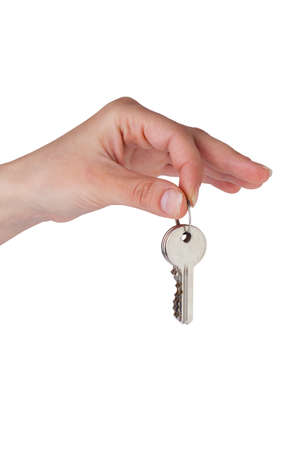 keys in hand on a white background