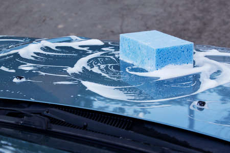 soap suds: a blue car is washing in soap suds