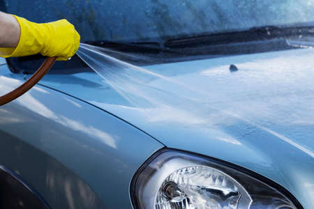 suds: blue car is washing in soap suds