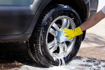 car wheel is washing in soap suds Stock Photo