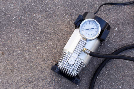 inflate: the pump to inflate automobile wheels  lying on the floor