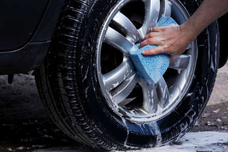 soap suds: car wheel is washing in soap suds Stock Photo