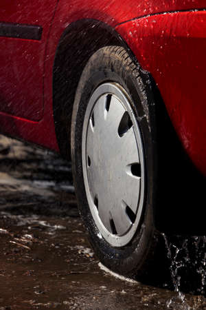 suds: car wheel is washing in soap suds Stock Photo