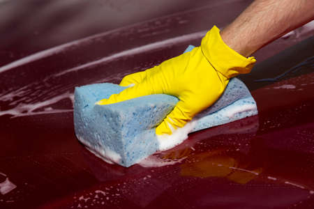 soap suds: red car is washing in soap suds Stock Photo
