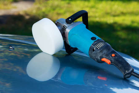 blue car is polishing on open air Stock Photo