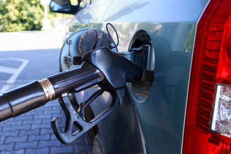 car fill with gasoline at a gas station Stock Photo