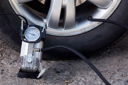 inflating: inflating the automobile wheels via a pump