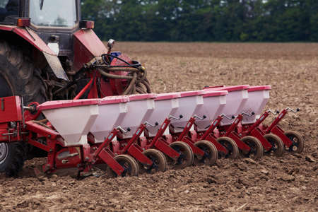 the agricultural machinery is working in field Stock Photo