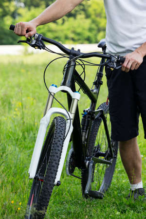 mtb: Young man riding a mountain bike in the woods Stock Photo