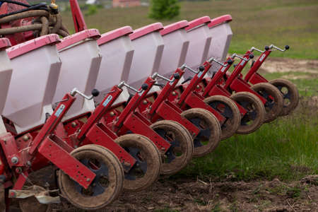 agrarian: the agricultural machinery is working in field Stock Photo