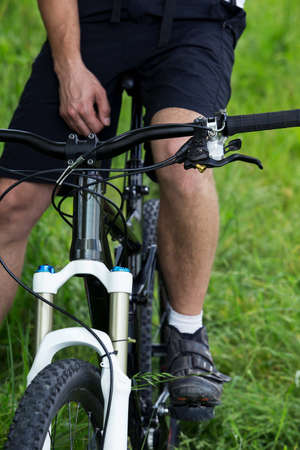 Young man riding a mountain bike in the woods Stock Photo