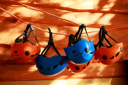 the several mountaineering helmets suspended on a rope Stock Photo
