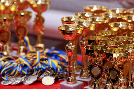 Golden cups for awarding winners on the table