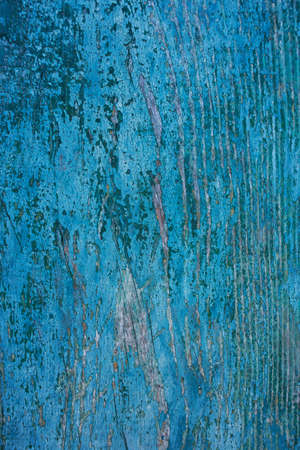 pitting: background of old blue paint on a wooden board