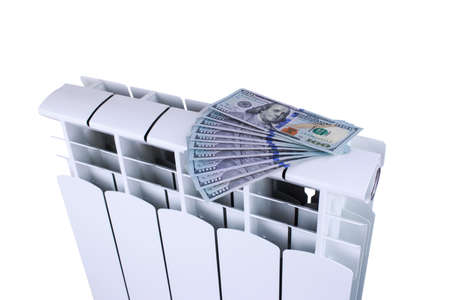 Radiator battery with dollars on a white background Banque d'images