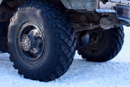 Machine with studded tires on the snow Stock Photo