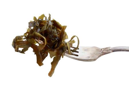The fresh sea kale on a fork