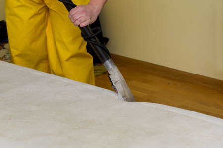 dry cleaning of an old white mattress